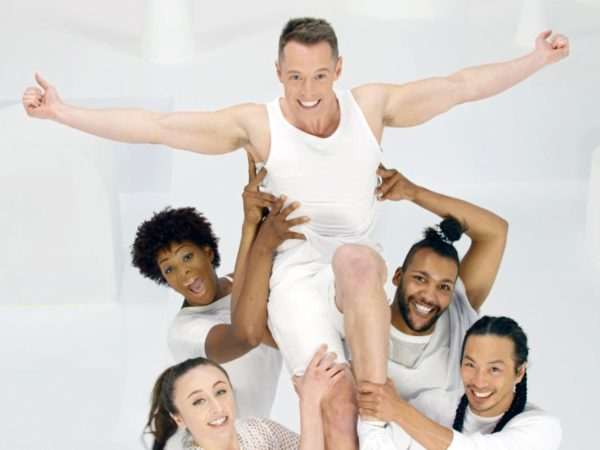 Davey Wavey being held up by dancers in an #HIVBeats video