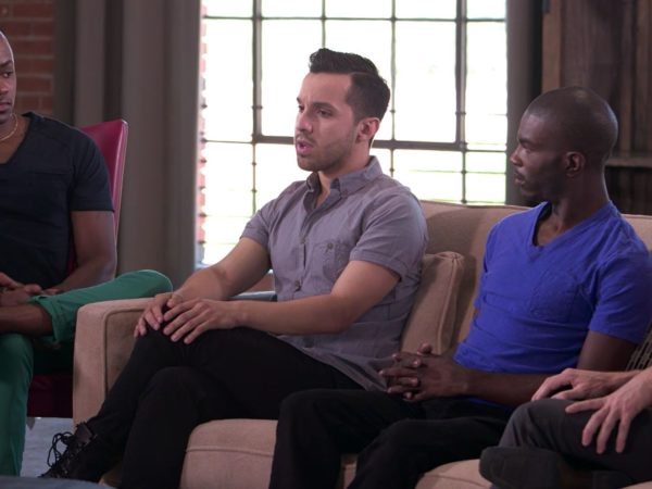 Three men talking as part of the group discussion between gay and bisexual men in Speak Out about HIV and the community