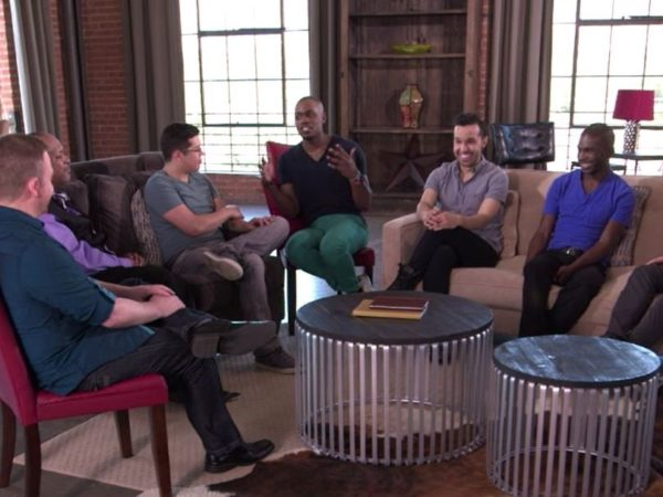 Six men smiling and talking as part of the group discussion between gay and bisexual men in Speak Out about HIV and the community