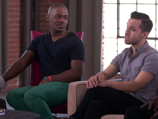 Two men talking as part of the group discussion between gay and bisexual men in Speak Out about HIV and the community