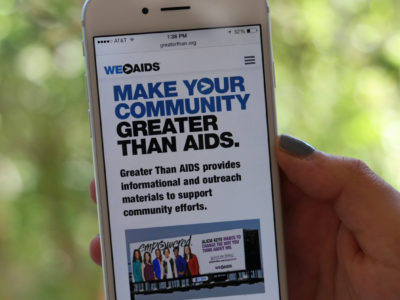 make your community greater than aids. photo of information on smartphone screen