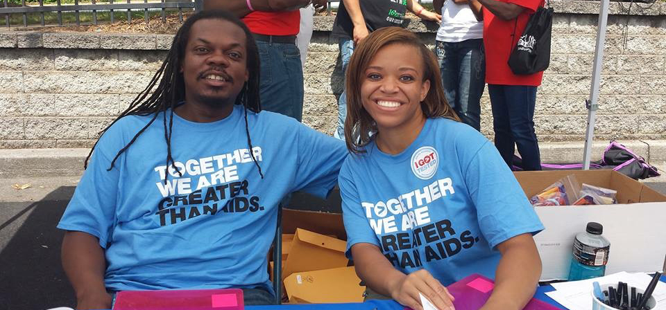 Man and woman smiling while volunteering with Walgreens and Greater Than AIDS for Free HIV testing day
