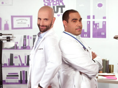 HIV specialists David and Demetre stand back to back