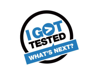"Black, blue, and white ""I got tested. What's next?"" button"