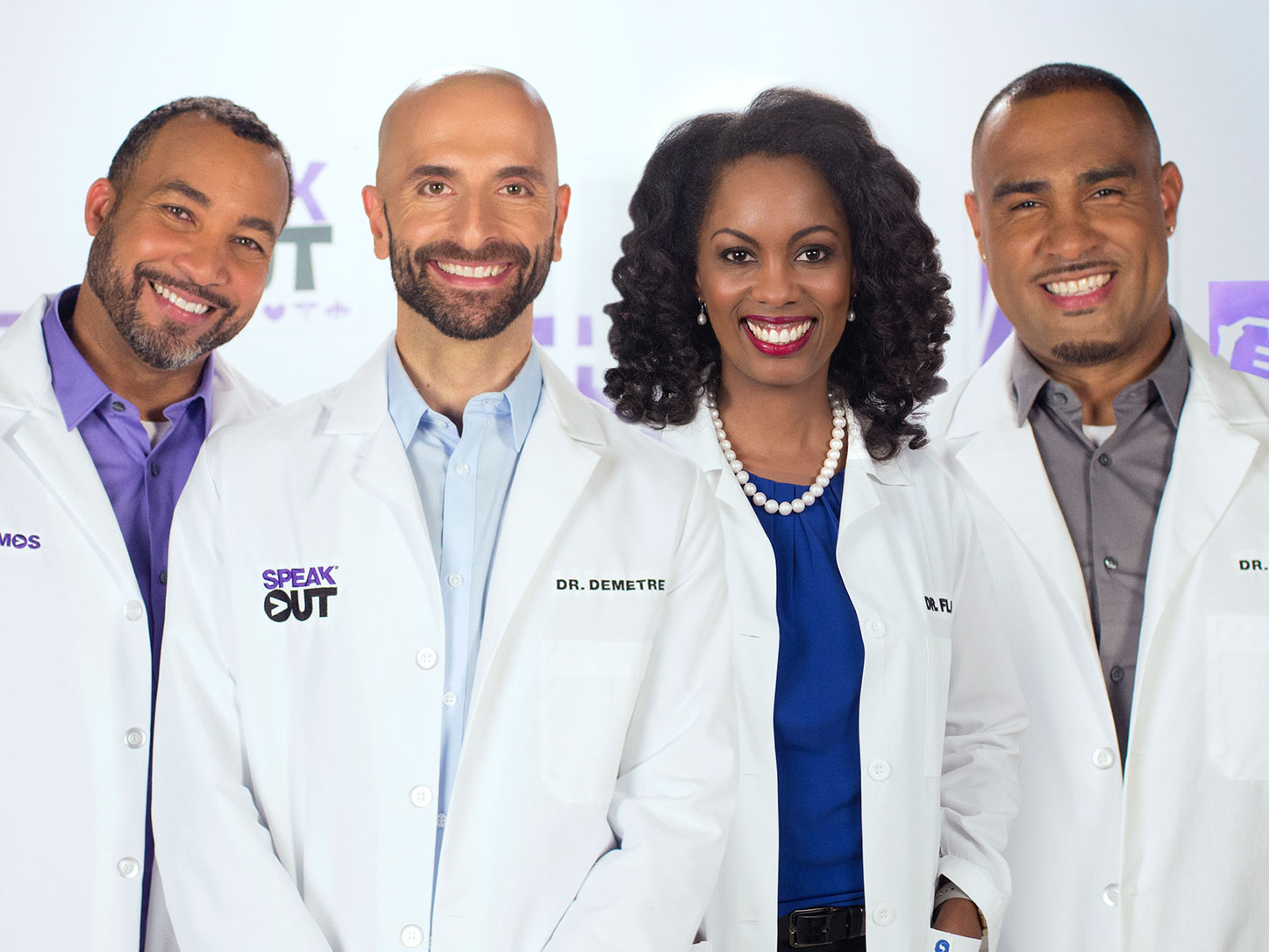 Four HIV specialists smiling