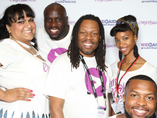 Five men and women pose at Greater Than AIDS event in New Orleans