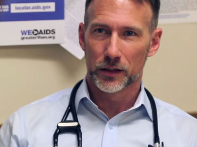 Male HIV doctor with a stethoscope around his neck.