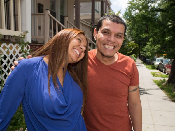 A Latino man and woman smiling