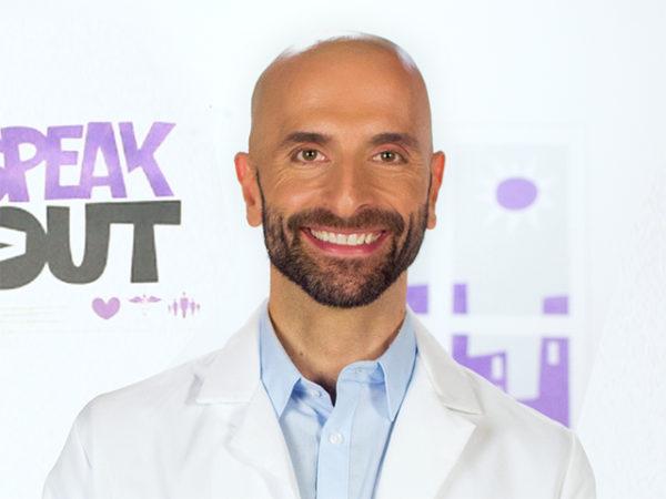 HIV doctor Demetre Daskalakis smiling on the #AskTheHIVDoc set