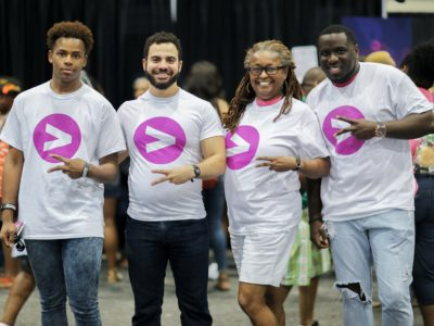 Group at the Greater Than AIDS booth at #ESSENCEFEST