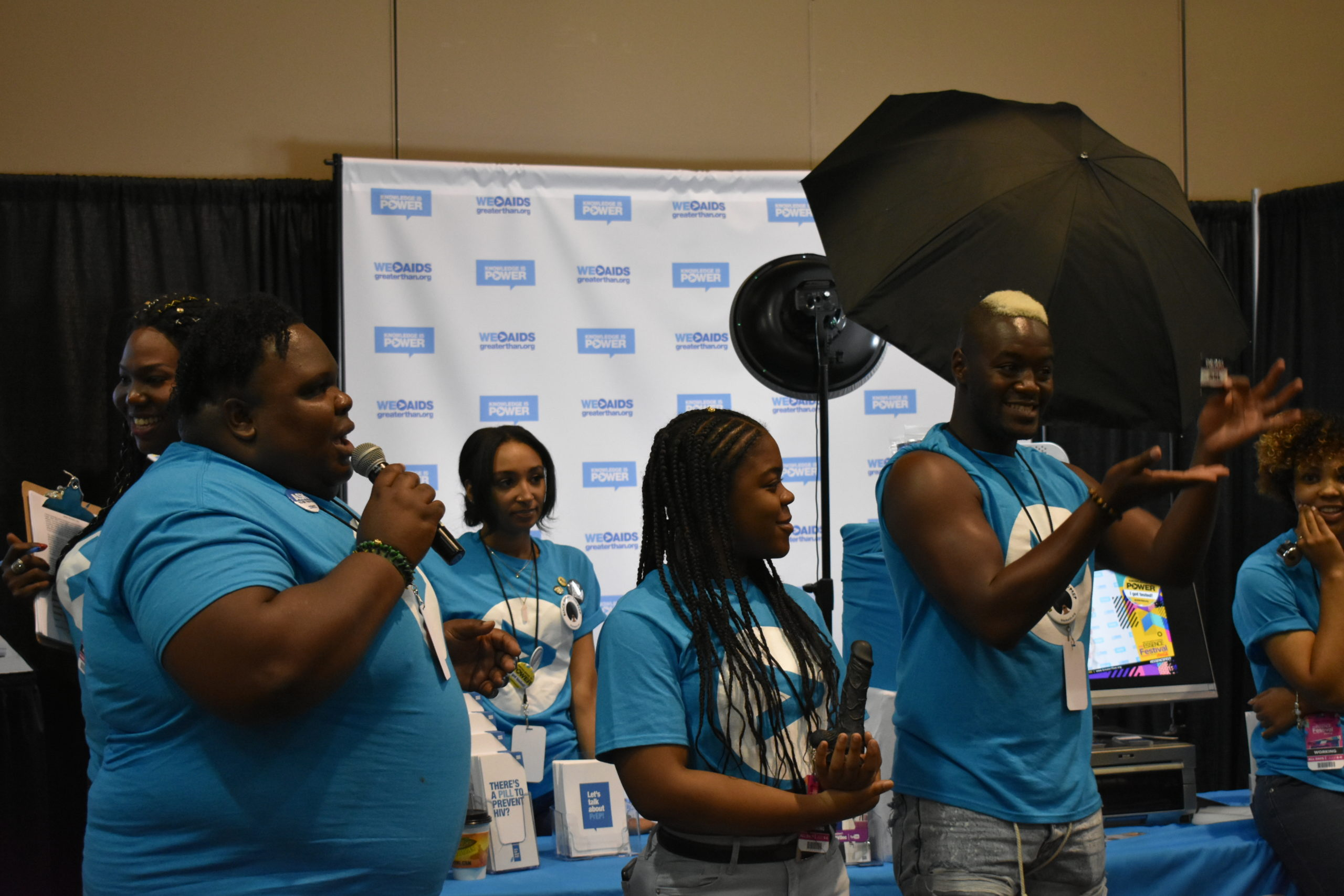 Smiling people at #ESSENCEFest 2018 in blue GTA shirts