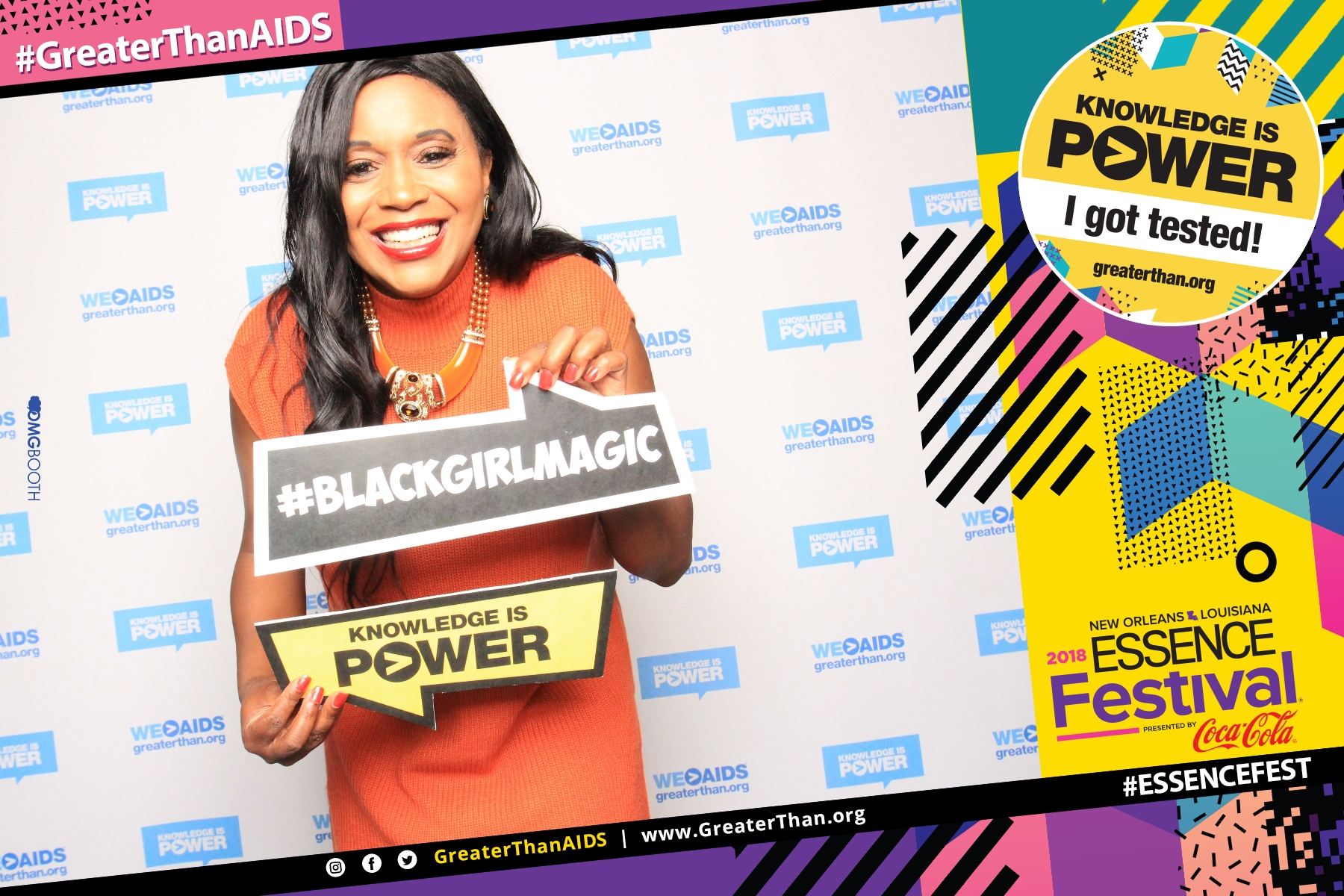 "Woman holding signs reading #BlackGirlMagic and ""Knowledge Is Power "" at #ESSENCEFest 2018"