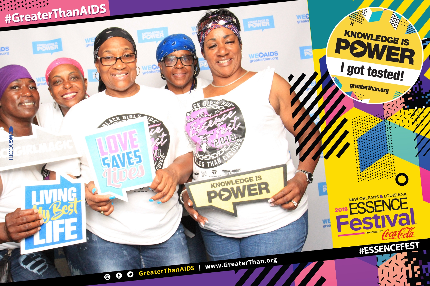"Women holding signs saying ""Living My Best Life,"" Love Saves Lives"" and Knowledge is Power"" at #ESSENCEFest 2018"
