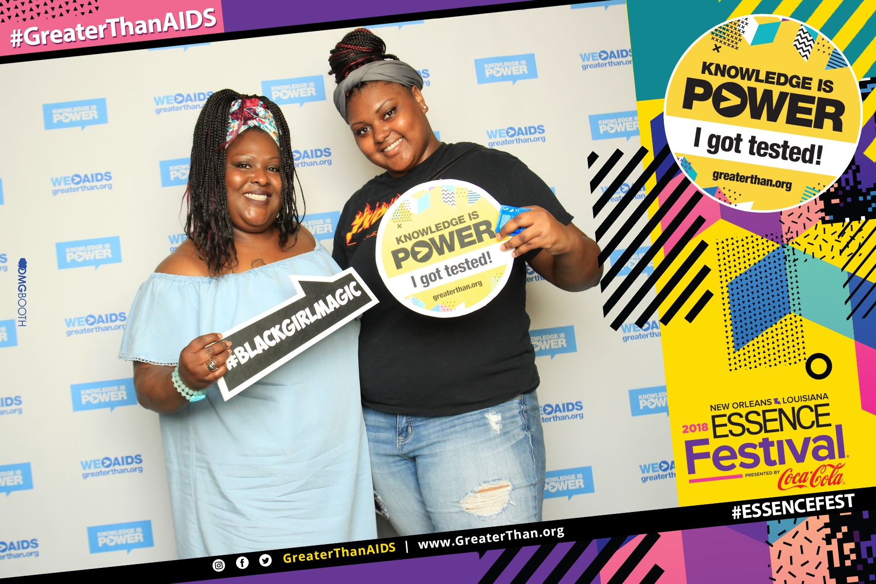 "Two women holding signs reading #BlackGirlMagic and ""Knowledge Is Power - I Got Tested!"" at #ESSENCEFest 2018"