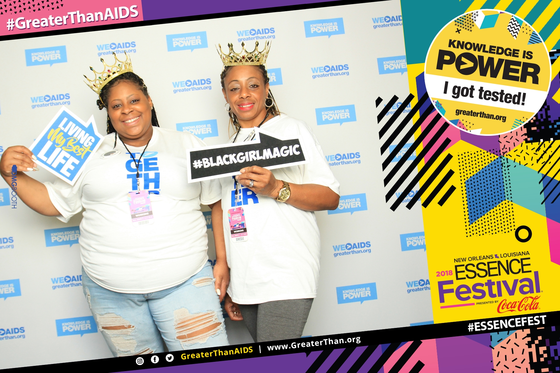 "Two women holding signs reading ""Living My Best Life"" and ""#BlackGirlMagic"" at #ESSENCEFest 2018"