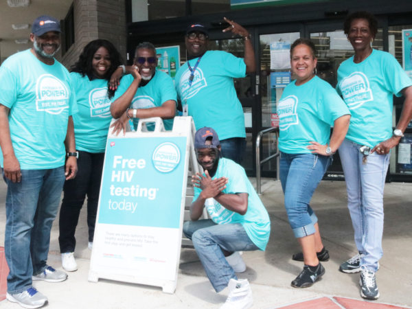 People standing with Free HIV testing sign