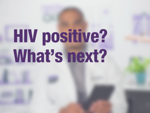 "Graphic with text ""HIV positive? What's next?"" with doctor in background"