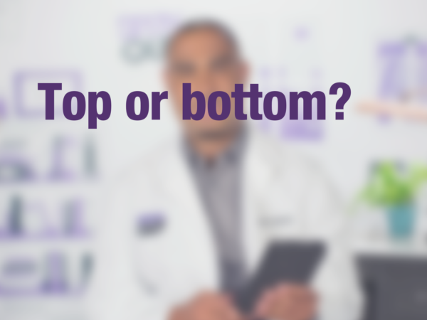 "Graphic with text ""Top or bottom?"" with doctor in background"
