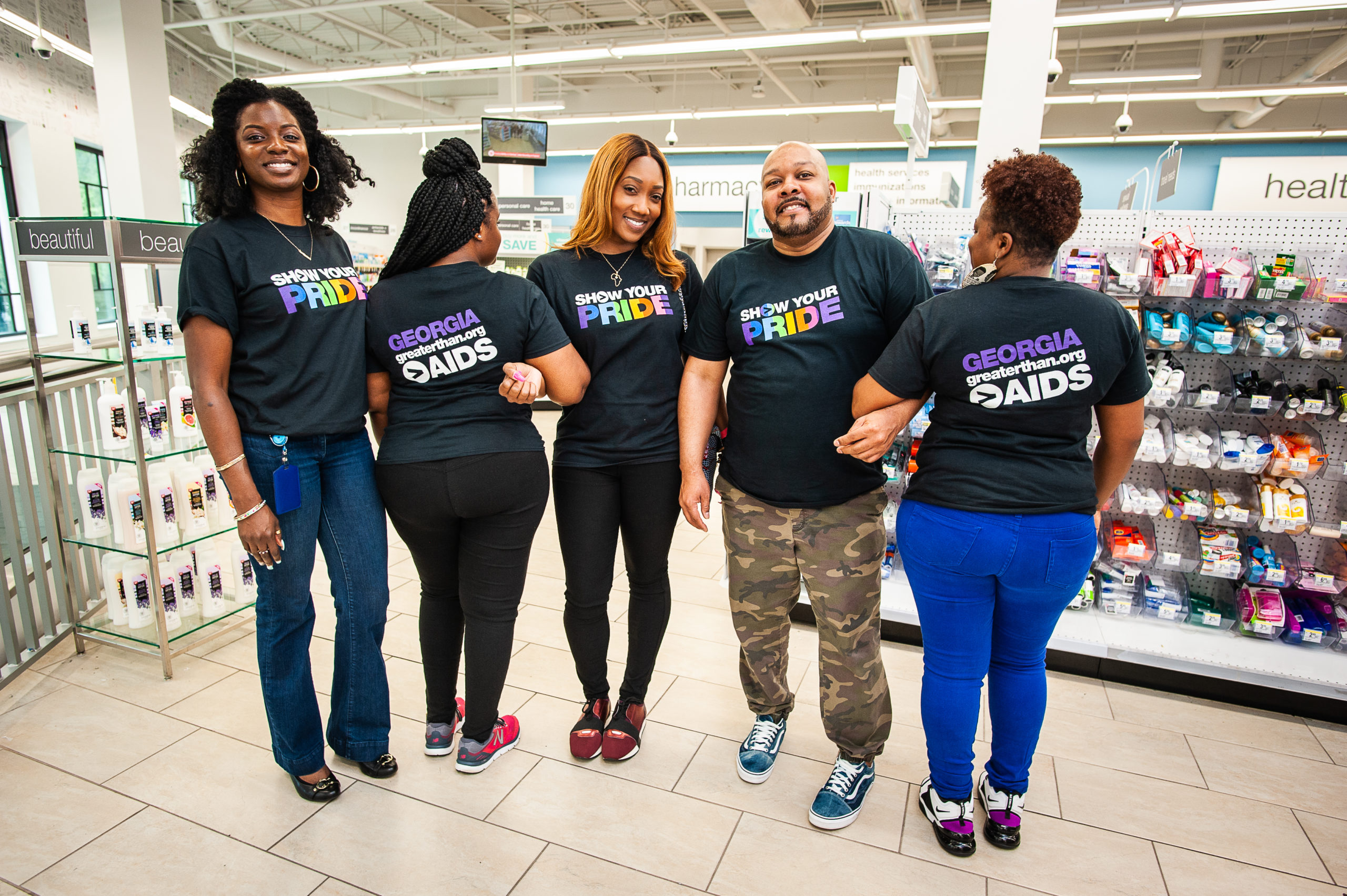 People smiling in a Walgreens for National HIV testing day